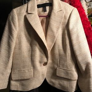 Ladies cream blazer with gold accents to material